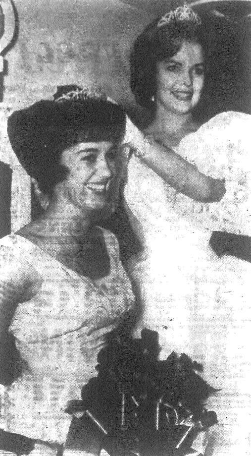 Valdene Garner, of Brownwood, left, the new queen of the Texas Farm Bureau, is crowned by last year's queen, Anita Koop of Edna, at the farm bureau's convention here Monday evening. Published in the San Antonio News Nov. 13, 1962. Photo: File Photo