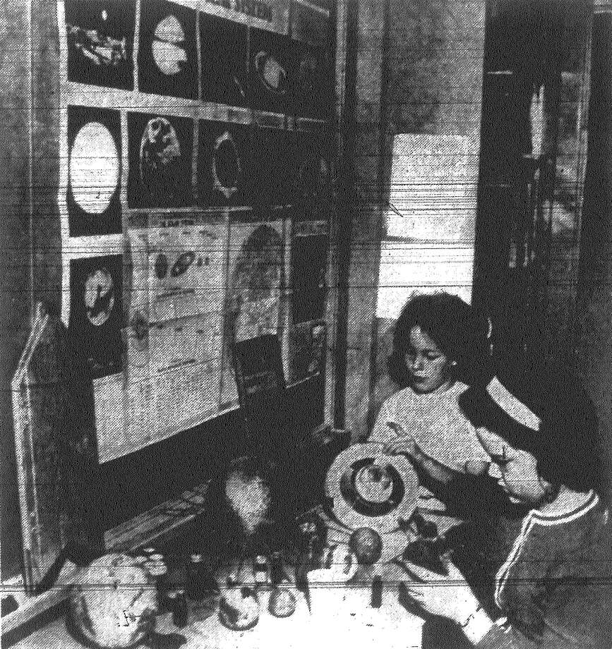 Diane Grey and Susan Scott, foreground, sixth graders at Mildred Baskin Elementary School, provide the finishes touches on an inter-planetary display.  Published in the San Antonio Light Nov. 4, 1962. Photo: File Photo