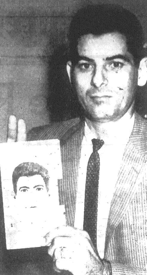 Detective Vic Abate demonstrates a drawing of himself which was produced by the new Ident-I-Kit, a police kit being used here to identify criminals. Using certain code numbers, police say, a person's physical description may be relayed to the mechanism which, in turn, produces a likeness of the individual described. Published in the San Antonio Express Nov. 12, 1962. Photo: File Photo
