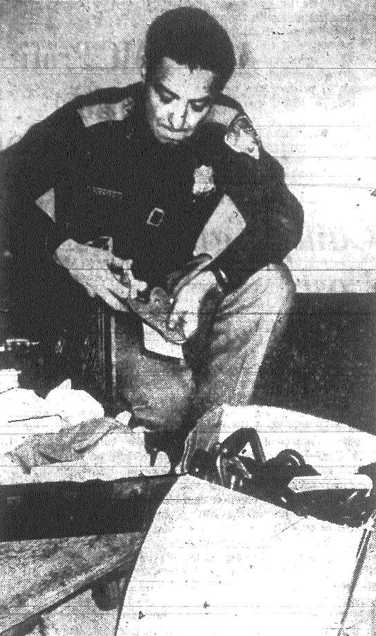 San Antonio police — tipped by a neighbor and aided by Lady Luck — thwarted what appeared to be a planned burglary and safe cracking at an H-E-B store on W. Commerce. Here Patrolman Rudy Fuentes examines a pistol, other weapons, tools and dynamite taken from an auto. Published in the San Antonio Light Nov. 16, 1962. Photo: File Photo