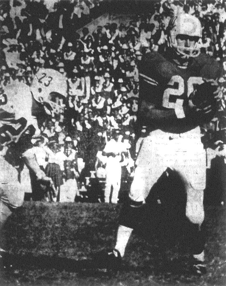 Anthony King, a former Jefferson High School back, takes a Texas pass at his 31-yard line in the Thanksgiving Day game at Austin. George Hargett is the Aggie in the picture. Texas beat Texas A&M 13-3. Published in the San Antonio Express Nov. 23, 1962. Photo: File Photo