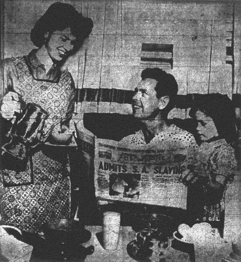 Daughter Sarah, 5, looks on as Mr. and Mrs. Charlo Bernd read the new sunrise edition of the San Antonio Light. Published in the San Antonio Light Nov. 18, 1962. Photo: File Photo