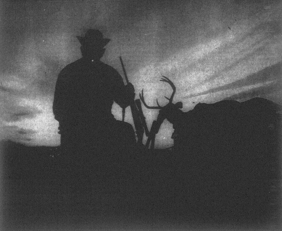 Vernon Jones, foreman of the Y.O. Ranch in Kerr County and one of the hunting guides on the ranch during the deer and turkey seasons, pauses on his way to headquarters with a client's trophy to watch a magnificent Hill Country sunset. Published in the San Antonio News Nov. 29, 1962. Photo: File Photo