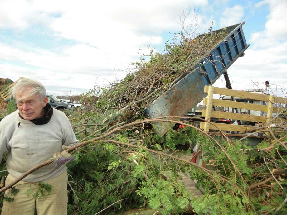 Norman Hildes-Heim, a resident of Fairfield since 1944, unloads his truck of tree branches at Green Cycle in Fairfield for the fifth time on Saturday, ìand Iím not anywhere near finished,î he said. Photo: Meg Barone / Westport News freelance