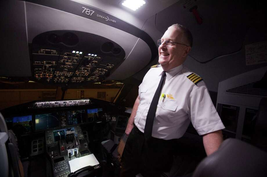 1st officer Cpt. Cliff Pittman talks to the media inside the cockpit as United Airlines - the North American launch customer for the Boeing 787 -prepared to fly its first scheduled commercial 787 flight from Houston to Chicago, with more than 200 customers on board Nov. 4, 2012 in Houston at Bush International Airport. Photo: Eric Kayne / © 2012 Eric Kayne