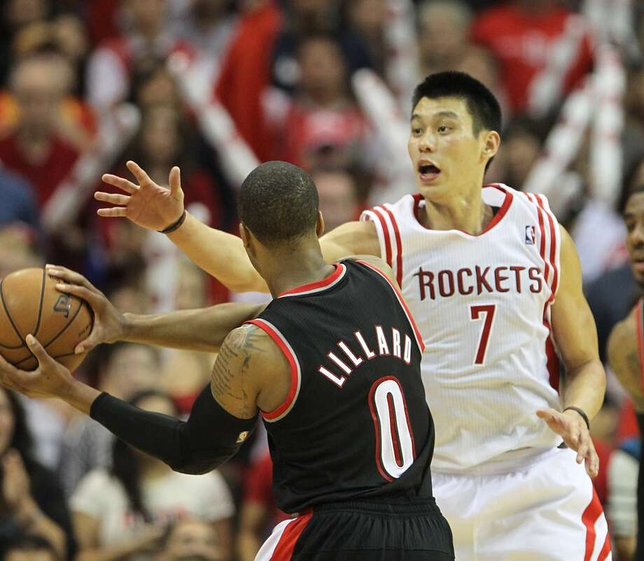 Blazers guard Damian Lillard attempts a pass around Rockets point guard Jeremy Lin. (Karen Warren / Houston Chronicle)