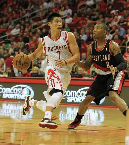 Rockets guard Jeremy Lin tries to get pas Damian Lillard of the Blazers. (Karen Warren / Houston Chr
