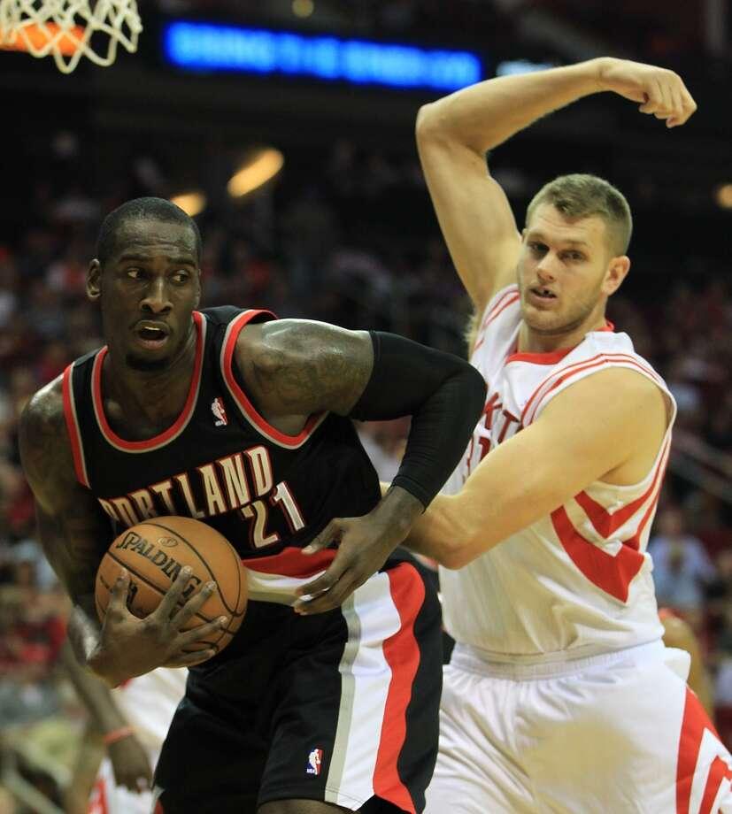 Blazers forward J.J. Hickson gets a rebound by Rockets center Cole Aldrich. (Karen Warren / Houston Chronicle)