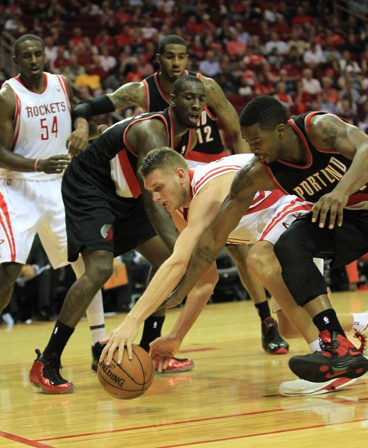 Rockets center Cole Aldrich tries to maintain possession of the ball. (Karen Warren / Houston Chronicle)
