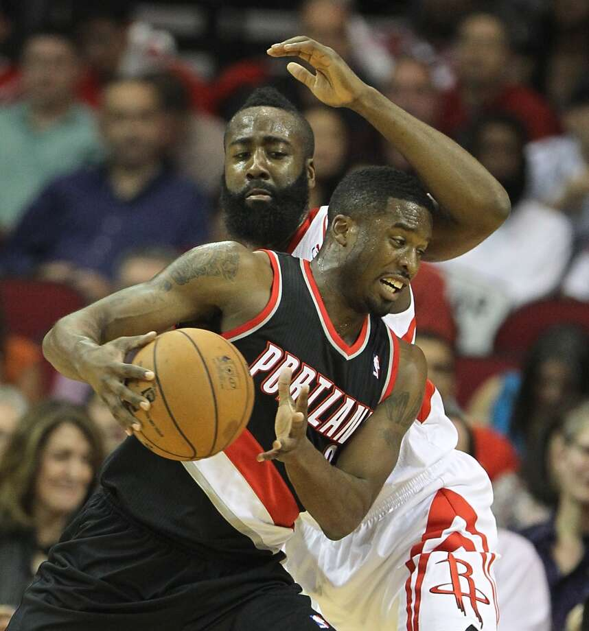 Rockets guard James Harden plays defense on Wesley Matthews of the Blazers. (Karen Warren / Houston Chronicle)