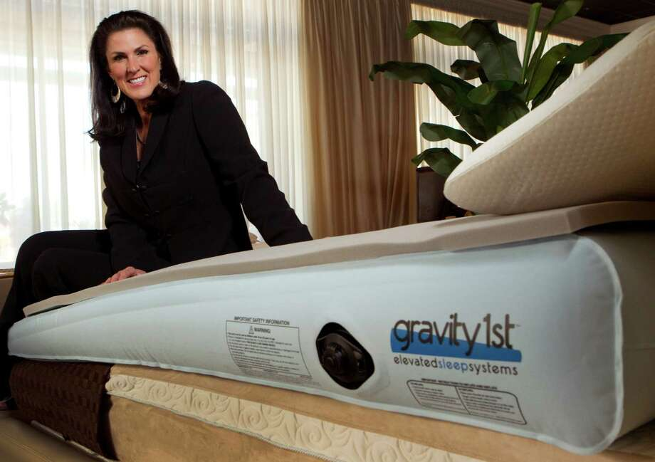 "Kelli Minson, CEO of Gravity Solutions, displays her creation. ""I was never really in this for the money,"" Minson says of the Gravity1st inflatable mattress. ""If I can prevent one person from getting esophageal cancer - wouldn't that be something?"" Photo: Brett Coomer, Houston Chronicle / © 2012 Houston Chronicle"