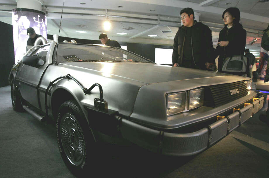 Back to the Future: The DeLorean may be the most iconic car on the silver screen. A modified DeLorean DMC-12 was used as a time machine in the trilogy. The car's wacky design left a lasting impression on consumers. Photo: EUGENE HOSHIKO / AP