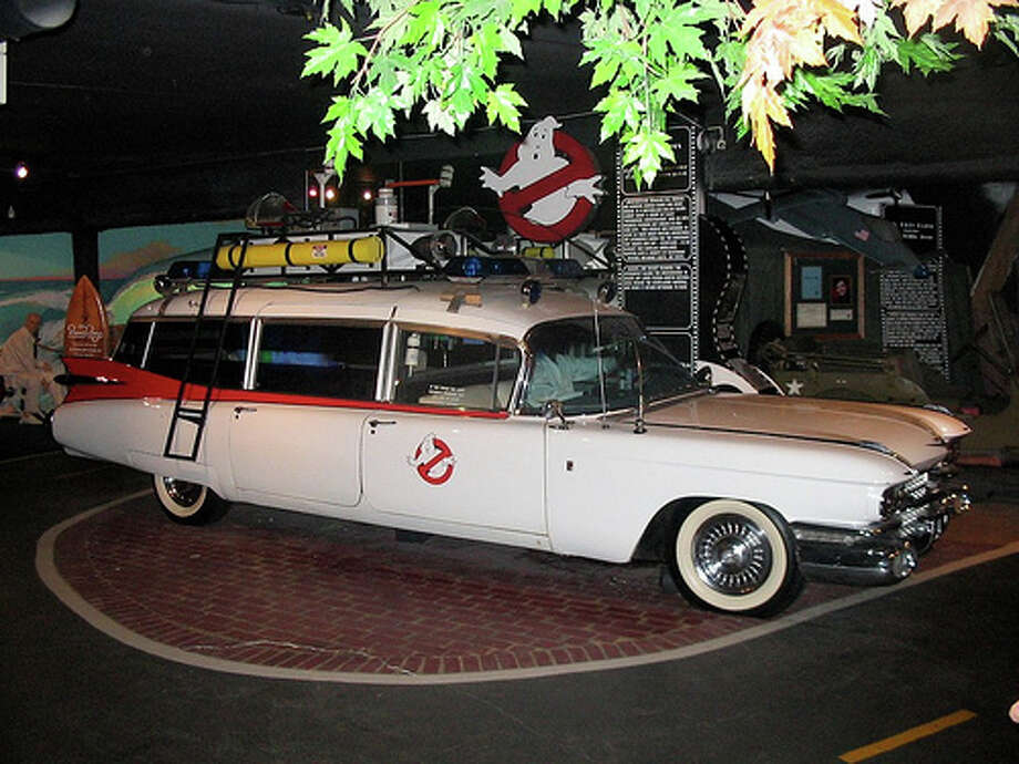 """Ghostbusters: In the film, Ray, who was played by Dan Aykroyd, bought a 1959 Cadillac Miller-Meteor for $4,800. He'd later add that all it needed was """"suspension work and shocks, brakes, brake pads, lining, steering box, transmission, rear-end, new rings, mufflers, a little wiring."""" A studio replica was bought for $80,000 in 2010. (Photo: Astopy, Flickr)"""