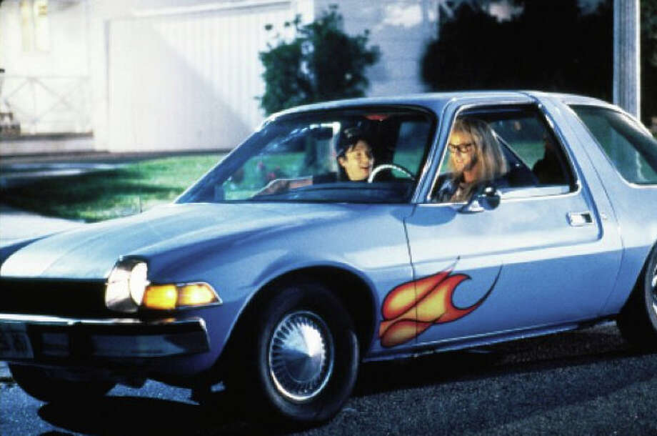 """Wayne's World: Garth drove an AMC Pacer in the movie. The car was dubbed the """"Mirth Mobile."""" Unlike other cars on this list, the AMC Pacer didn't make it big after its time on the big screen. Edmunds rated the AMC Pacer as one of the 50 worst cars of all-time."""