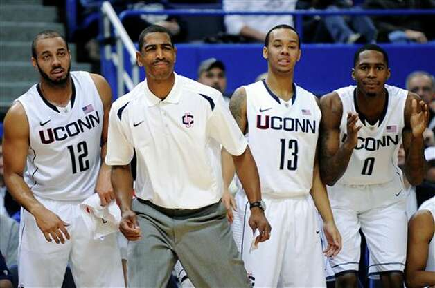 UConn coach Kevin Ollie watches action during the first half of their  exhibition NCAA college basketball game against Massachusetts Lowell in  Hartford, Conn., Sunday, Nov. 4, 2012. (AP Photo/Fred Beckham)