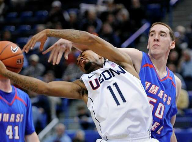 Ryan Boatright (11) is fouled by Massachusetts Lowell's James McDonnell  during the first half of an exhibition NCAA college basketball game in  Hartford, Conn., Sunday, Nov. 4, 2012. (AP Photo/Fred Beckham)