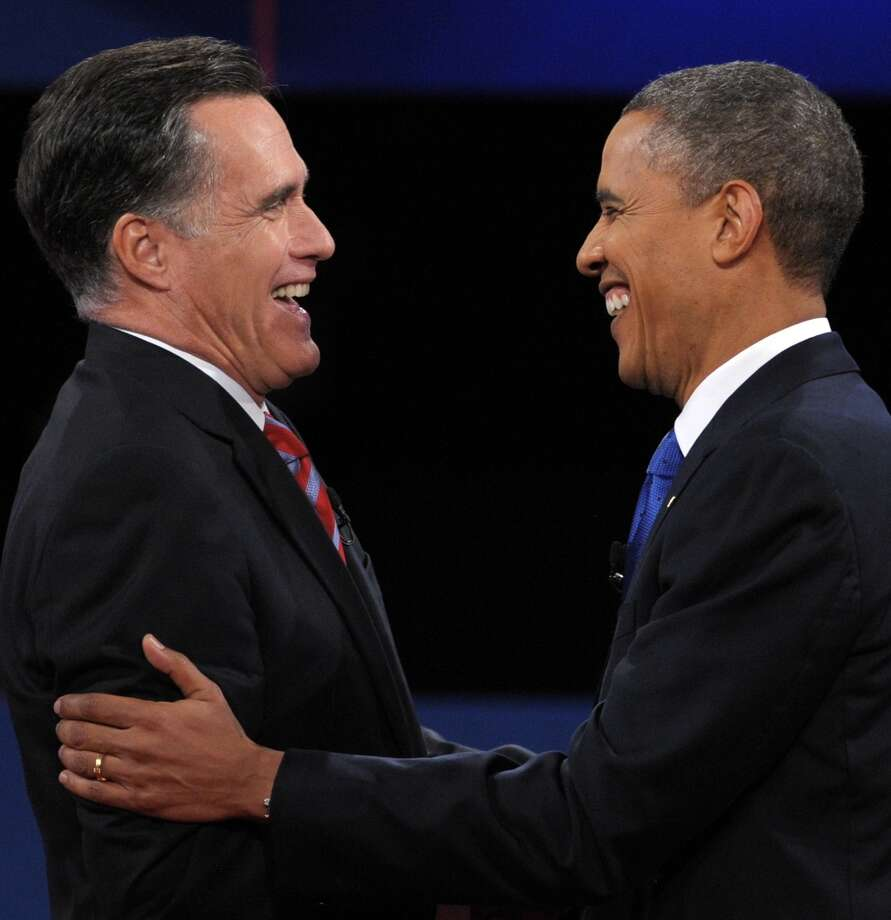 US President Barack Obama (R) greets Republican presidential candidate Mitt Romney (L) following the third and final presidential debate at Lynn University in Boca Raton, Florida, October 22, 2012. The showdown focusing on foreign policy is being held in the crucial toss-up state of Florida just 15 days before the election and promises to be among the most watched 90 minutes of the entire 2012 campaign. AFP PHOTO / Saul LOEBSAUL LOEB/AFP/Getty Images Photo: SAUL LOEB, AFP/Getty Images / AFP