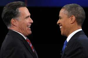 US President Barack Obama (R) greets Republican presidential candidate Mitt Romney (L) following the third and final presidential debate at Lynn University in Boca Raton, Florida, October 22, 2012. The showdown focusing on foreign policy is being held in the crucial toss-up state of Florida just 15 days before the election and promises to be among the most watched 90 minutes of the entire 2012 campaign. AFP PHOTO / Saul LOEBSAUL LOEB/AFP/Getty Images