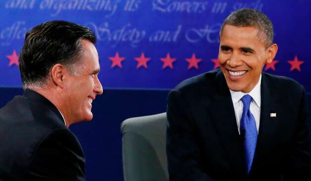 President Barack Obama and Republican presidential nominee Mitt Romney smile during the third presidential debate at Lynn University, Monday, Oct. 22, 2012, in Boca Raton, Fla. (AP Photo/Pool-Rick Wilking) Photo: Rick Wilking, Associated Press / Reuters Pool
