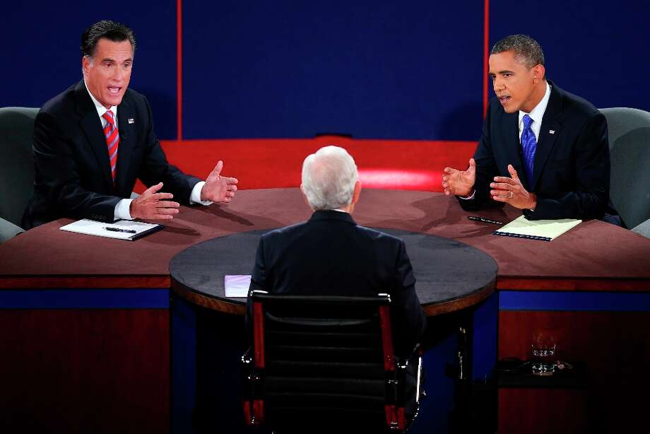 Republican presidential nominee Mitt Romney and President Barack Obama answer a question during the third presidential debate at Lynn University, Monday, Oct. 22, 2012, in Boca Raton, Fla. (AP Photo/Pool-Win McNamee) Photo: Win McNamee, Associated Press / Getty Pool