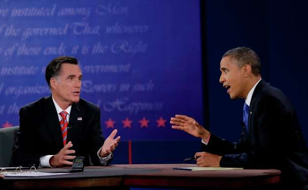 President Barack Obama, right, and Republican presidential nominee Mitt Romney discuss a point during the third presidential debate at Lynn University, Monday, Oct. 22, 2012, in Boca Raton, Fla. (AP Photo/Eric Gay) Photo: Eric Gay, Associated Press / AP