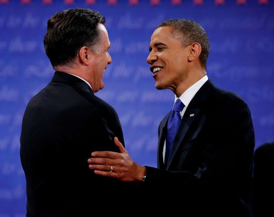 President Barack Obama, right, and Republican presidential nominee Mitt Romney shakes hands following their third presidential debate at Lynn University, Monday, Oct. 22, 2012, in Boca Raton, Fla. (AP Photo/David Goldman) Photo: David Goldman, Associated Press / AP