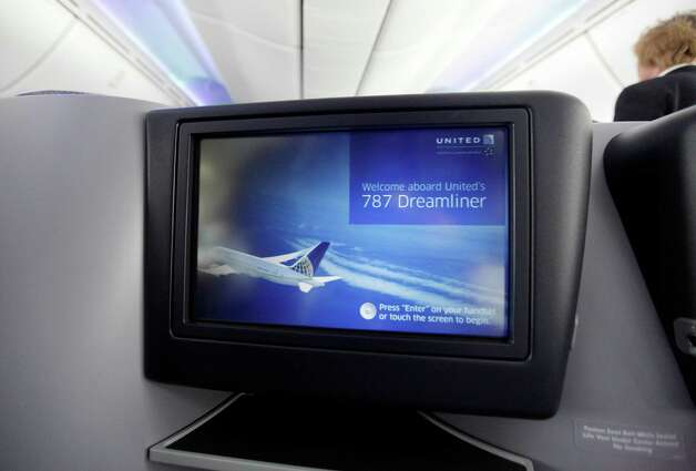 An upgraded video screen on the back of a seat of United Airlines' new Boeing 787 Dreamliner is shown after the aircraft's inaugural revenue flight from Houston to Chicago, at O'Hare international Airport in Chicago, Sunday, Nov. 4, 2012. Photo: AP