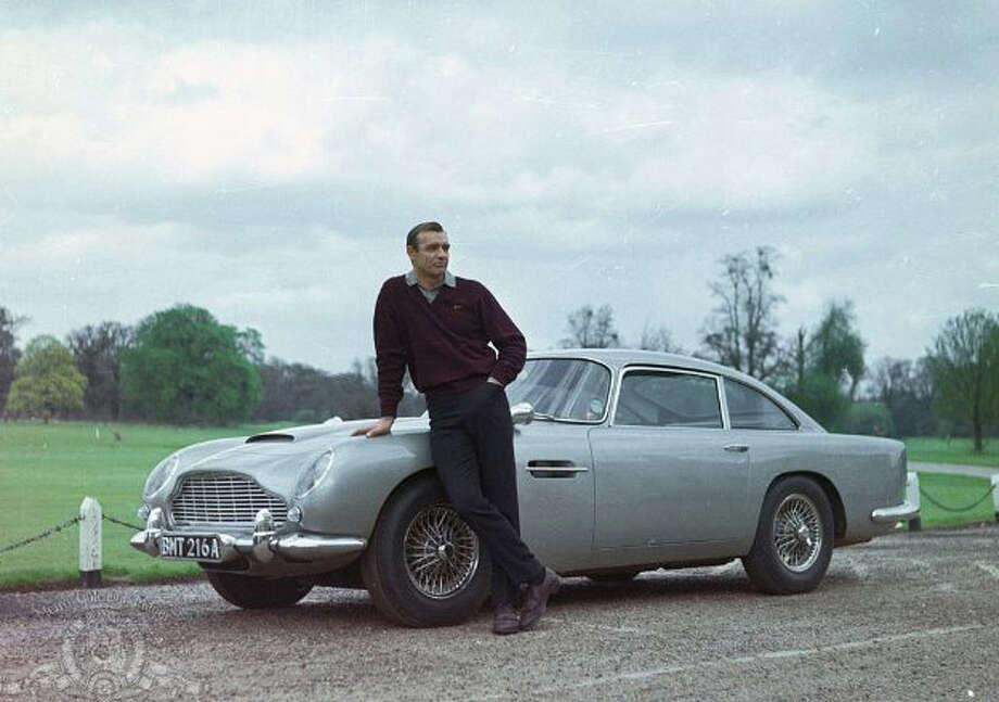 1964 Goldfinger and 1965 Thunderball: 1963 Aston Martin DB5. The original movie car sold for $4.1 million in London in 2010.  Photo: Metro-Goldwyn-Mayer Studios Inc.