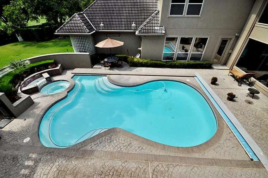 The pool has an attached hot tub and space for lounging. Photo: Picasa, RE/MAX Of Texas