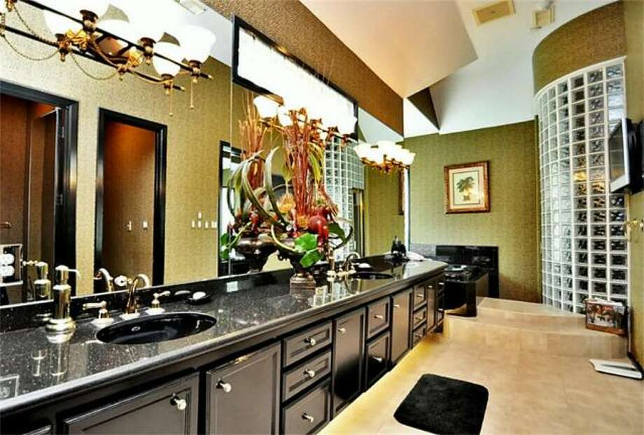 The master bathroom has black granite countertops and ample counter space. Photo: Picasa, RE/MAX Of Texas