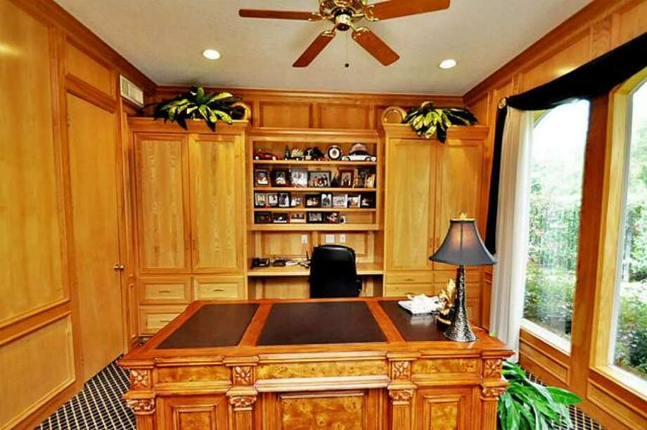 The study has solid-wood walls, shelves and floors. Photo: Picasa, RE/MAX Of Texas