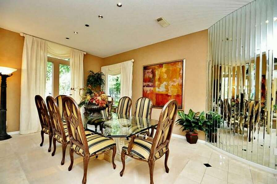 The dining room has glass French doors that lead out to the back of the property.