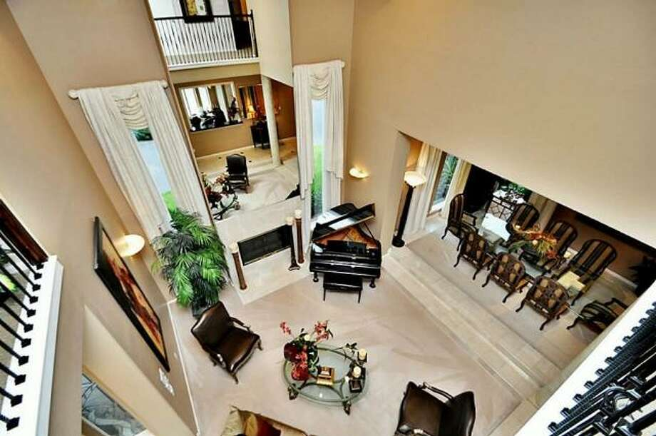 The balcony overlooks the living room. Photo: Picasa, RE/MAX Of Texas