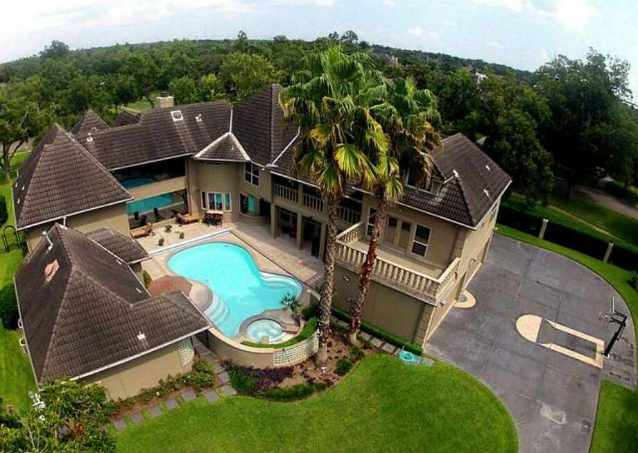 The back of the property includes a pool, hot tub and basketball court. Photo: Picasa, RE/MAX Of Texas