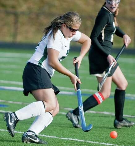 New Milford High School's Lindsey Heaton moves the ball into Joel Barlow High School territory in an SWC field hockey semifinal game at Immaculate. Sunday, Nov. 4, 2012 Photo: Scott Mullin / The News-Times Freelance