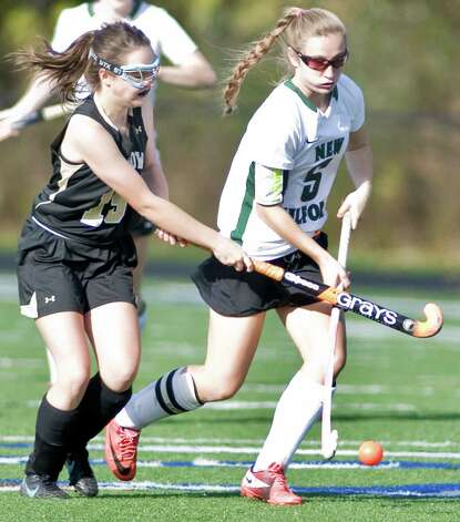 Joel Barlow High School's Emma O'Leary tries to block New Milford High School's Emily Sanders during an SWC field hockey semifinal game at Immaculate. Sunday, Nov. 4, 2012 Photo: Scott Mullin / The News-Times Freelance