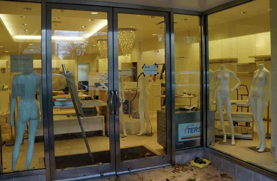 Mannequins are stripped nude of their clothing at the Ann Taylor store in downtown Westport as the business restores merchandise displays in the wake of Hurricane Sandy. Photo: Paul Schott / Westport News