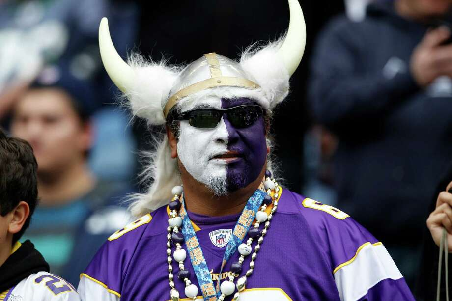 A Minnesota Vikings fan watches team warm-ups prior to an NFL football game against the Seattle Seahawks, Sunday, Nov. 4, 2012, in Seattle. Photo: AP