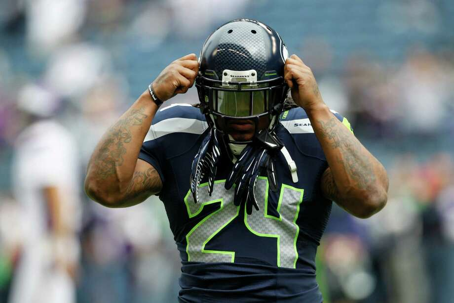 Seattle Seahawks' Marshawn Lynch adjusts his helmet during warm-ups prior to an NFL football game against the Minnesota Vikings, Sunday, Nov. 4, 2012, in Seattle. Photo: AP