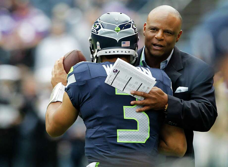 Seattle Seahawks quarterback Russell Wilson, left, is greeted by Seahawks' legend Warren Moon during warm-ups before an NFL football game against the Minnesota Vikings, Sunday, Nov. 4, 2012, in Seattle. Photo: AP