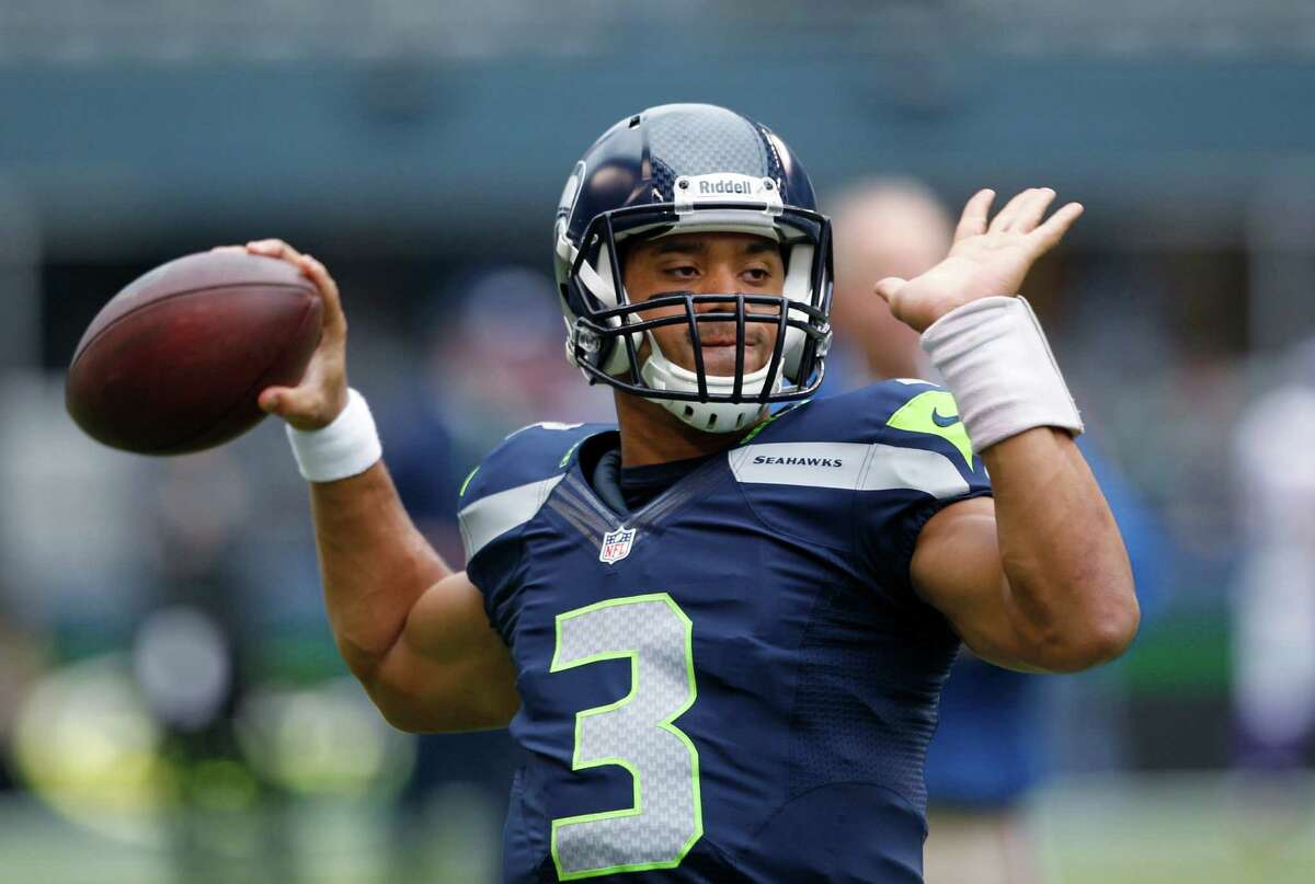Seattle Seahawks quarterback Russell Wilson warms up before an NFL football game against the Minnesota Vikings, Sunday, Nov. 4, 2012, in Seattle.
