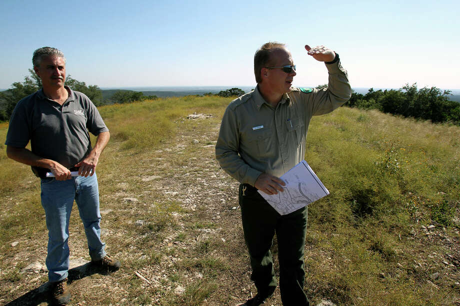 Chris Collins (left) and Chris Holm check the view on possible land additions to the Government Canyon State Natural Area  on October 30, 2012. Photo: Tom Reel, San Antonio Express-News / ©2012 San Antono Express-News