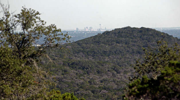 Downtown San Antonio can be seen in the distance from a hilltop on possible land additions to the Government Canyon State Natural Area  on October 30, 2012. Photo: Tom Reel, San Antonio Express-News / ©2012 San Antono Express-News