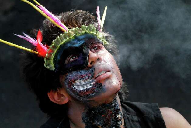 A man in costume takes part in the Zombie Walk in Mexico City, Saturday, Nov. 3, 2012. According to the organization Zombie Walk Mexico, they are trying to set a new Guinness World Record of the biggest Zombie Walk. (AP Photo/Marco Ugarte) Photo: Marco Ugarte, Associated Press / AP