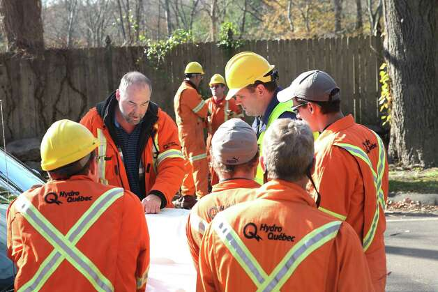 Mike Ross Connecticut Post - Crews from Hydro-Québec go over maps and discuss repair plans to restore power to residents on Lake Avenue in Greenwich on Sunday afternoon. Photo: Mike Ross / Connecticut Post Freelance