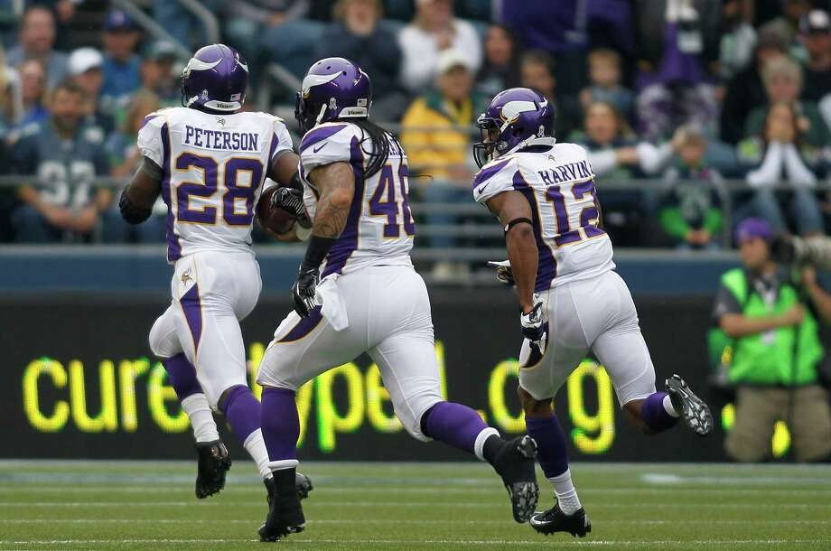 Minnesota Vikings' Adrian Peterson (28) breaks free for a 74-yard run against the Seattle Seahawks next to Vikings' Matt Asiata (48) and Percy Harvin (12) in the first half of an NFL football game, Sunday, Nov. 4, 2012, in Seattle. Photo: AP