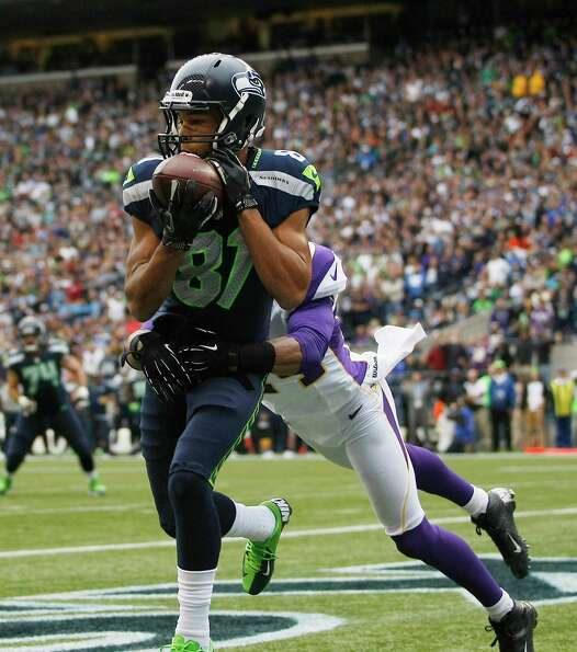 Seattle Seahawks' Golden Tate catches a pass for a touch down as Minnesota Vikings' A.J. Jefferson d