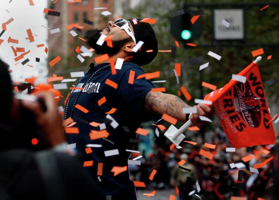 Sergio Romo posed for the crowd as the confetti came down on Market Street. The San Francisco Giants celebrated their second World Series title in three years with a parade down Market Street Wednesday October 31, 2012. Photo: Brant Ward, The Chronicle / ONLINE_YES