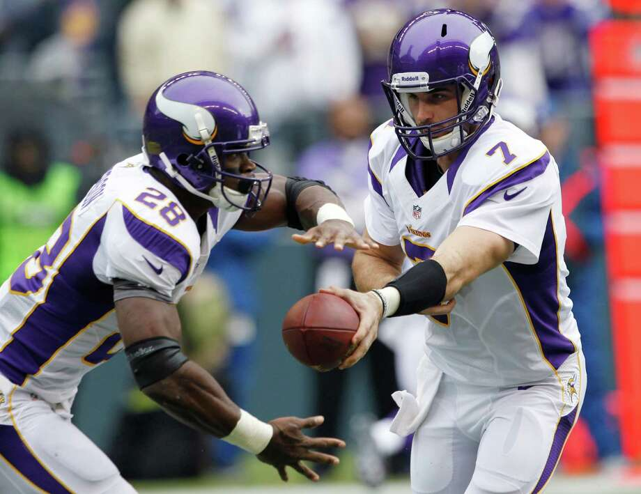Minnesota Vikings quarterback Christian Ponder (7) hands off to Adrian Peterson (28) during the first half of an NFL football game against the Seattle Seahawks, Sunday, Nov. 4, 2012, in Seattle. Photo: AP
