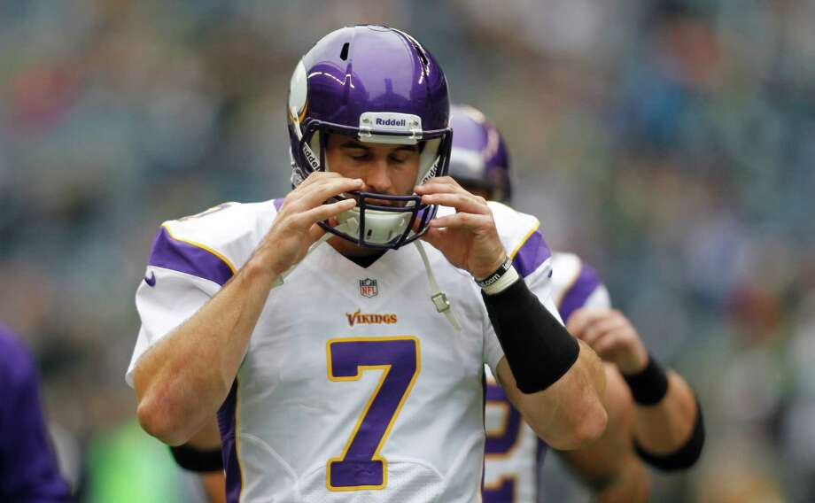 Minnesota Vikings quarterback Christian Ponder adjusts his helmet during warm-ups prior to an NFL football game against the Minnesota Vikings, Sunday, Nov. 4, 2012, in Seattle. Photo: AP